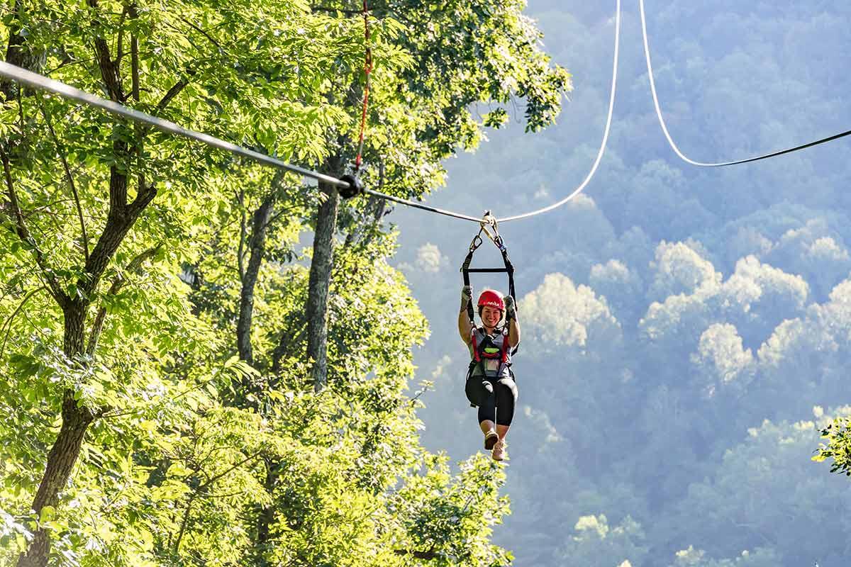 ziplining through treetops in Asheville NC