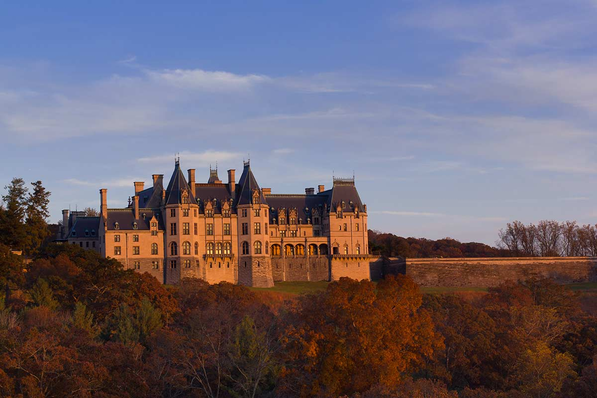sunset shot of Biltmore House in the fall Asheville NC