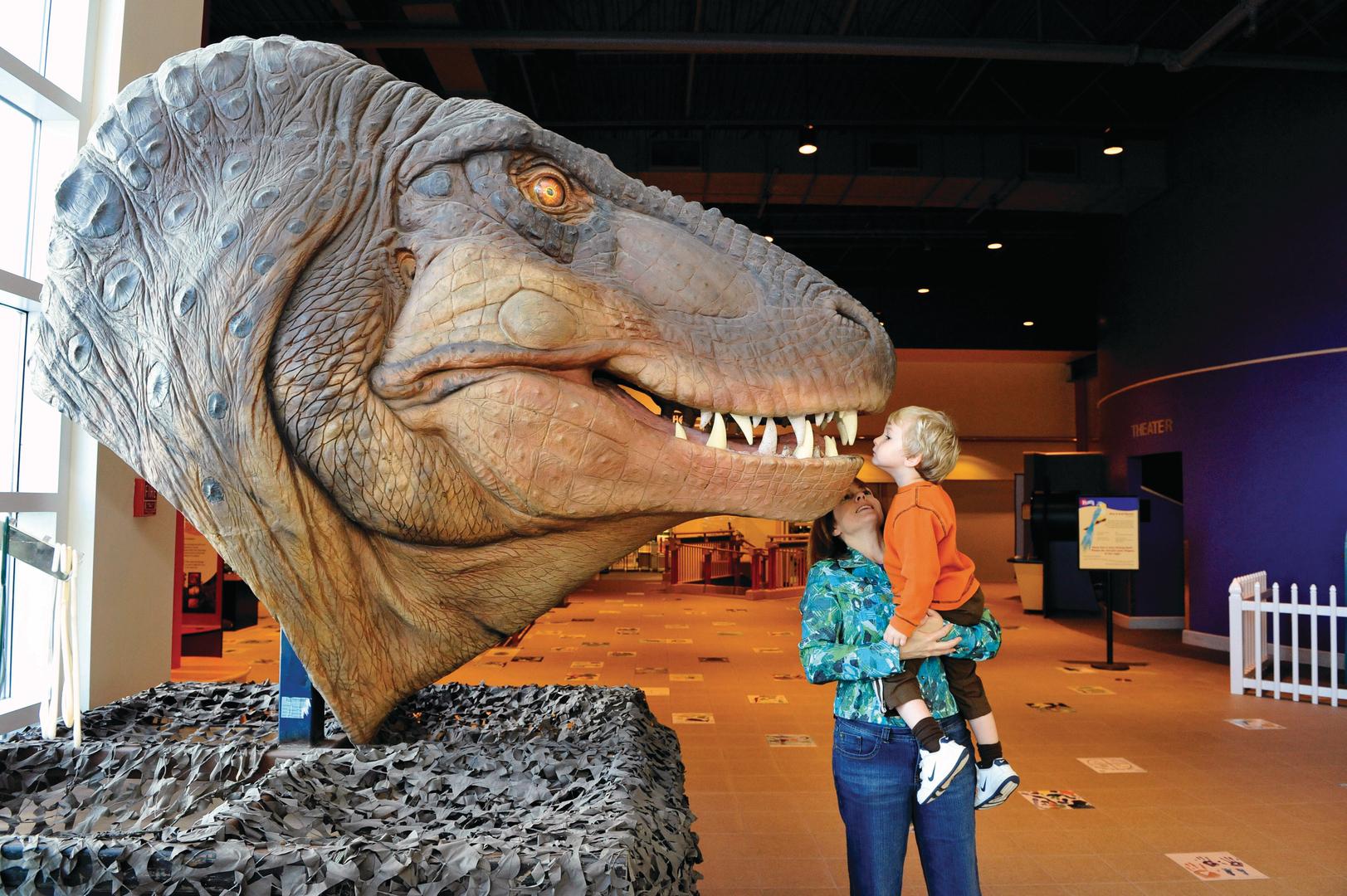 child with dinosaur at Kaleideum North Winston Salem NC