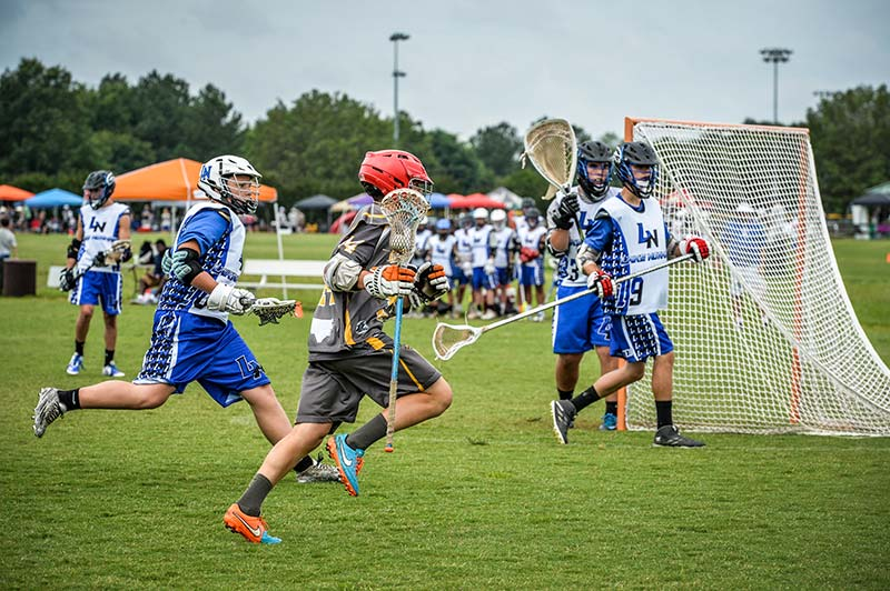 Lacrosse Players on the field at Frank Like Park Concord NC